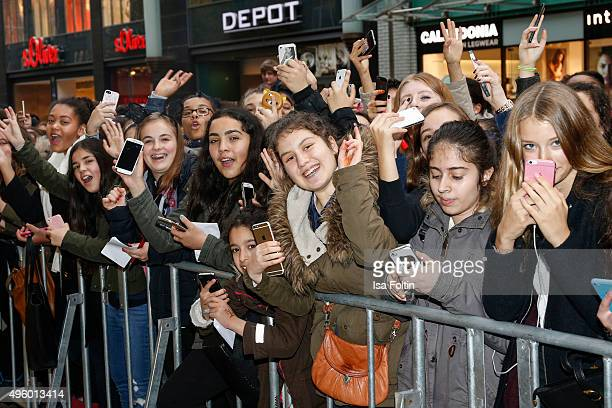 Fans are waiting for Ariana Grande during the Meet Greet With Ariana Grande to promote her debut fragrance 'Ari by Ariana Grande' on November 06 2015...