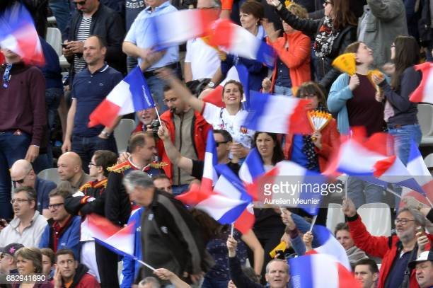 Fans are waving flags during the HSBC Paris sevens match between France and New Zealand on May 14 2017 in Paris France