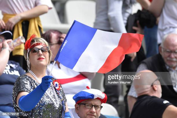Fans are waving flags during the HSBC rugby sevens match between France and Kenya on May 13 2017 in Paris France