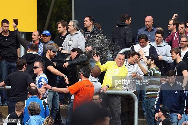 Fans argue in the stand during the Bundesliga match between SV Darmstadt 98 and Eintracht Frankfurt at MerckStadion am Boellenfalltor on April 30...