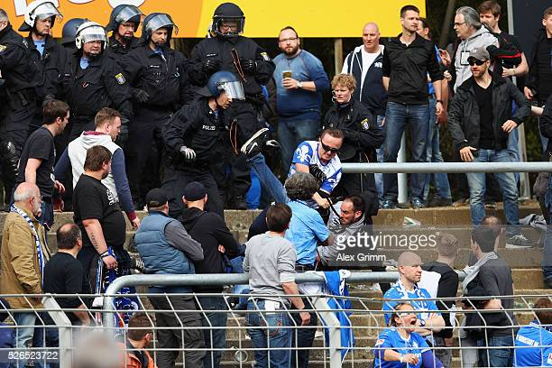 Fans argue in the stand during the Bundesliga match between SV Darmstadt 98 and Eintracht Frankfurt at Merck-Stadion am Boellenfalltor on April 30,...
