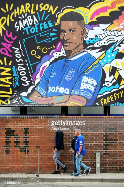 Fans arrive ahead of the Premier League match between Everton FC and Southampton FC at Goodison Park on August 18 2018 in Liverpool United Kingdom