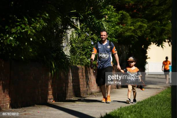 Fans arrive ahead of the round four NRL match between the Wests Tigers and the Melbourne Storm at Leichhardt Oval on March 26 2017 in Sydney Australia