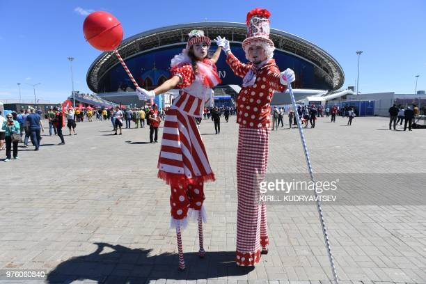 TOPSHOT Fans arrive ahead of the Russia 2018 World Cup Group C football match between France and Australia at the Kazan Arena in Kazan on June 16...