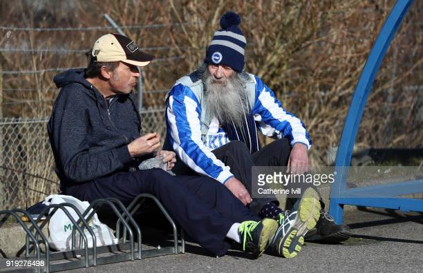 Fans arrive ahead of the The Emirates FA Cup Fifth Round between Brighton and Hove Albion v Coventry City at Amex Stadium on February 17 2018 in...