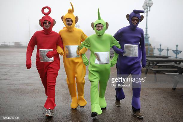 Fans arrive at Alexandra Palace dressed as Teletubbies for the quarter finals of the 2016 William Hill World Darts Championship on December 30 2016...