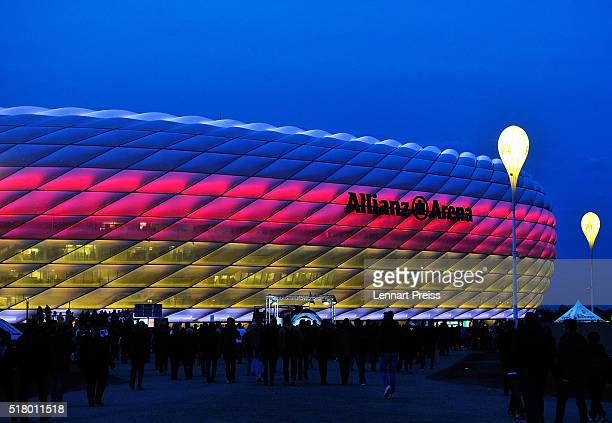 Fans arrive at Allianz Arena lit up in the colours of the German flag before the International Friendly match between Germany and Italy at Allianz...
