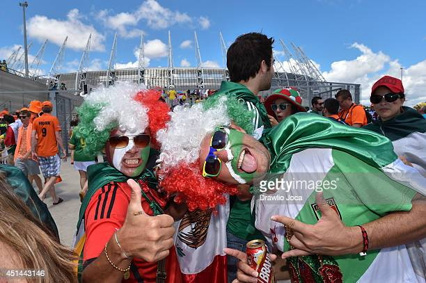 Fans arrive at Arena Castelao stadium for the Netherlands v Mexico Round of 16 match during the 2014 FIFA World Cup Brazil on June 29 2014 in...