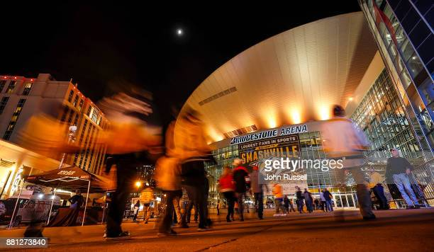 Fans arrive at Bridgestone Arena for an NHL game between the Nashville Predators and the Chicago Blackhawks on November 28 2017 in Nashville Tennessee