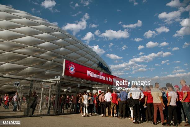 Fans arrive at the Allianz Arena prior to the German First division Bundesliga football match FC Bayern Munich vs Bayer 04 Leverkusen in Munich...