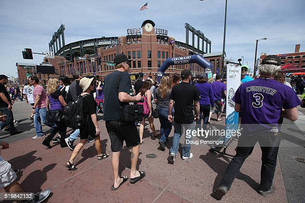 Fans arrive at the ballpark as the San Diego Padres face the Colorado Rockies during opening day at Coors Field on April 8 2016 in Denver Colorado
