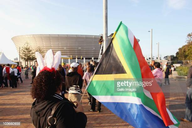 Fans arrive at the Cape Town Stadium before the Absa Premiership match between Vasco Da Gama and Orlando Pirates, at Cape Town Stadium on August 27,...