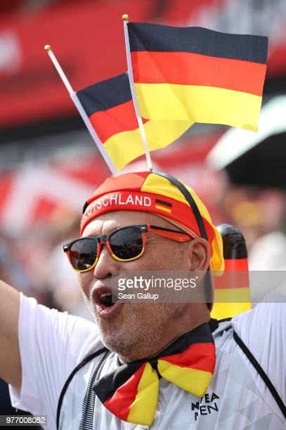 Fans arrive at the Fanmeile public viewing area to watch the Germany vs Mexico 2018 FIFA World Cup match on June 17 2018 in Berlin Germany Today's is...