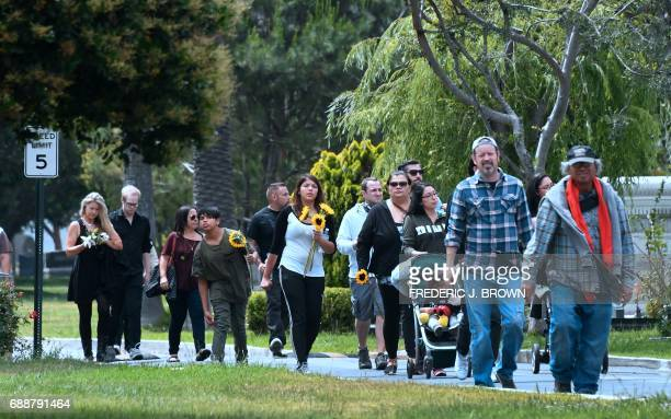 Fans arrive at the Hollywood Forever Cemetery to visit the grave of Soundgarden frontman Chris Cornell who was buried here at a funeral service...