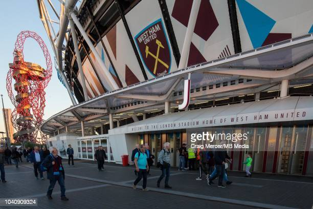 Fans arrive at The London Stadium before the Carabao Cup Third Round match between West Ham United and Macclesfield Town at The London Stadium on...