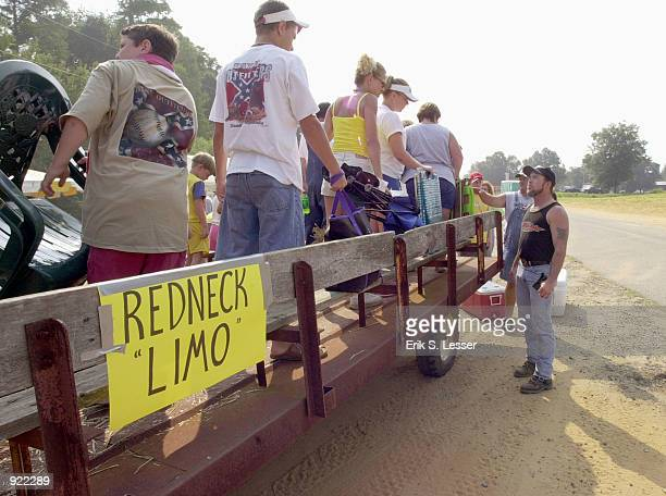 Fans arrive at the Seventh Annual Summer Redneck Games July 6, 2002 in East Dublin, Georgia. Thousands of people flock to the event that heralds...