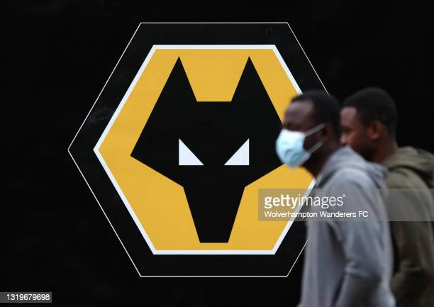 Fans arrive at the stadium ahead of the Premier League match between Wolverhampton Wanderers and Manchester United at Molineux on May 23, 2021 in...