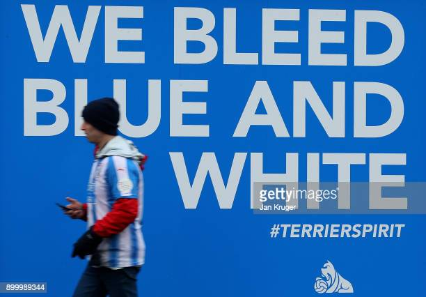 Fans arrive at the stadium ahead of the Premier League match between Huddersfield Town and Burnley at John Smith's Stadium on December 30 2017 in...