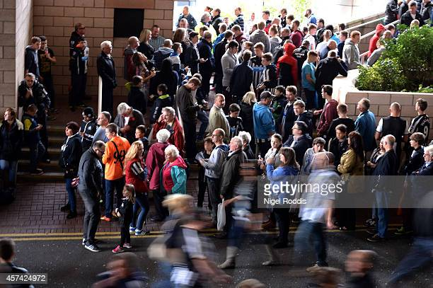 Fans arrive at the stadium during the Barclays Premier League match between Newcastle United and Leicester City at St James' Park on October 18 2014...