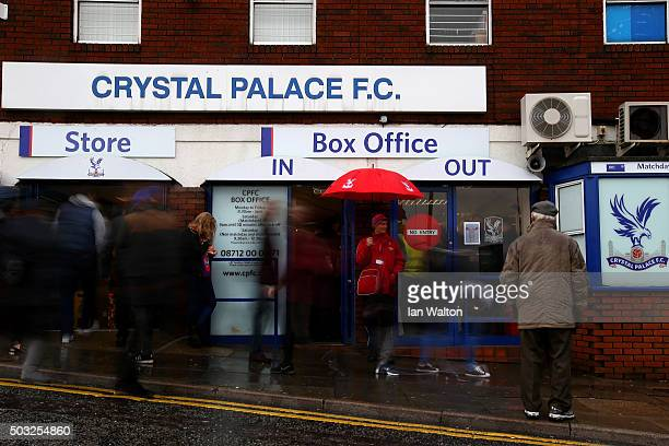 Fans arrive at the stadium for the Barclays Premier League match between Crystal Palace and Chelsea at Selhurst Park on January 3 2016 in London...