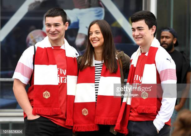 Fans arrive at the stadium prior to during the Premier League match between Arsenal FC and Manchester City at Emirates Stadium on August 12 2018 in...