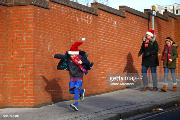 Fans arrive at the stadium prior to during the Premier League match between Crystal Palace and AFC Bournemouth at Selhurst Park on December 9 2017 in...