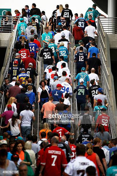 Fans arrive at the stadium prior to kickoff during the NFL match between the Oakland Raiders and the Miami Dolphins at Wembley Stadium on September...