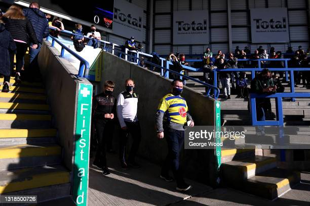 Fans arrive at the stadium prior to the Betfred Super League match between Warrington Wolves and Huddersfield Giants at The Halliwell Jones Stadium...