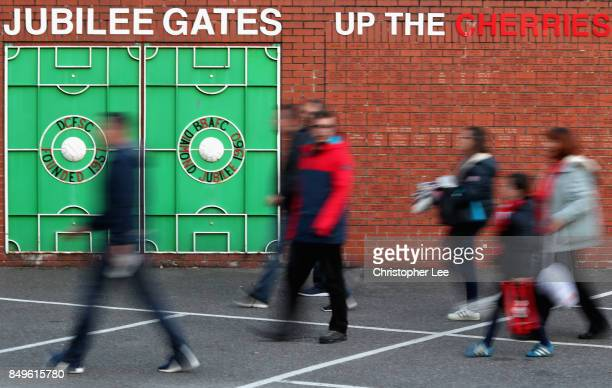 Fans arrive at the stadium prior to the Carabao Cup Third Round match between AFC Bournemouth and Brighton and Hove Albion at Vitality Stadium on...