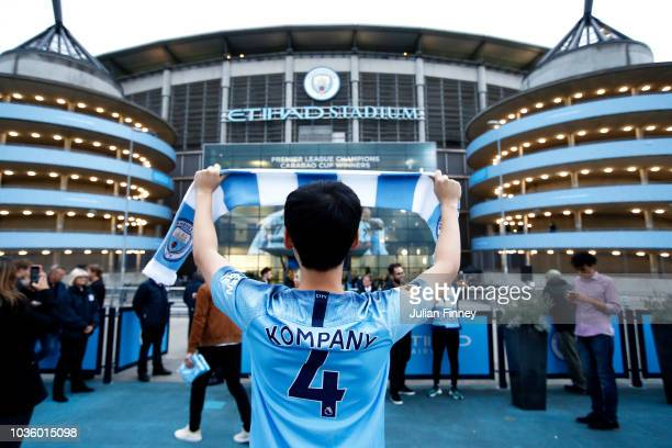 Fans arrive at the stadium prior to the Group F match of the UEFA Champions League between Manchester City and Olympique Lyonnais at Etihad Stadium...