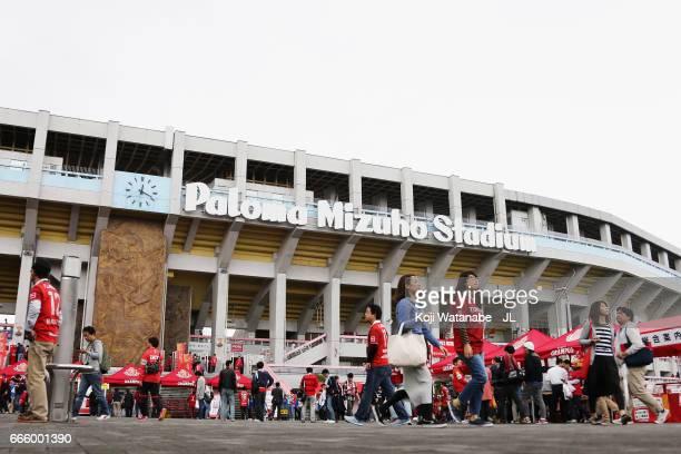 Fans arrive at the stadium prior to the J.League J2 match between Nagoya Grampus and Kamatamare Sanuki at Paroma Mizuho Stadium on April 8, 2017 in...