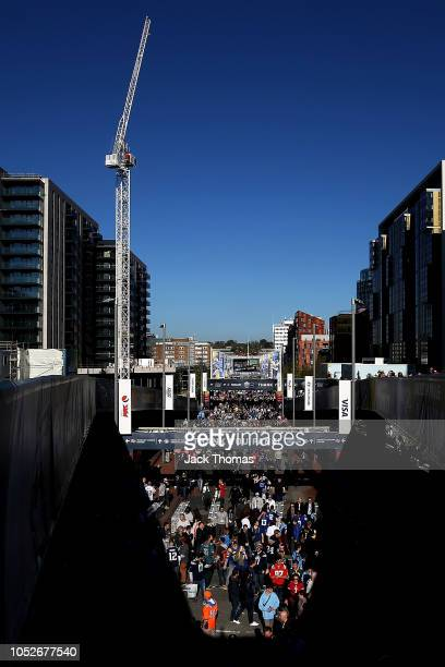 Fans arrive at the stadium prior to the NFL International Series game between Tennessee Titans and Los Angeles Chargers at Wembley Stadium on October...