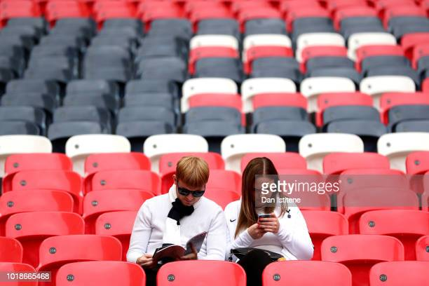 Fans arrive at the stadium prior to the Premier League match between Tottenham Hotspur and Fulham FC at Wembley Stadium on August 18 2018 in London...