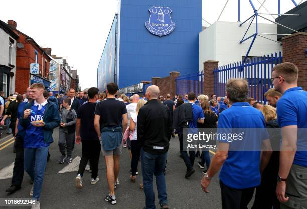 Fans arrive at the stadium prior to the Premier League match between Everton FC and Southampton FC at Goodison Park on August 18 2018 in Liverpool...