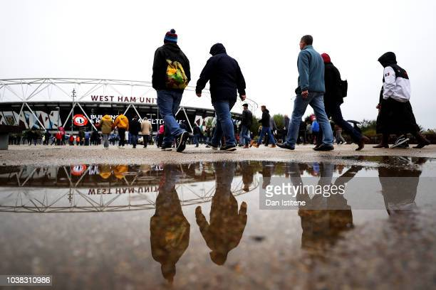 Fans arrive at the stadium prior to the Premier League match between West Ham United and Chelsea FC at London Stadium on September 23 2018 in London...