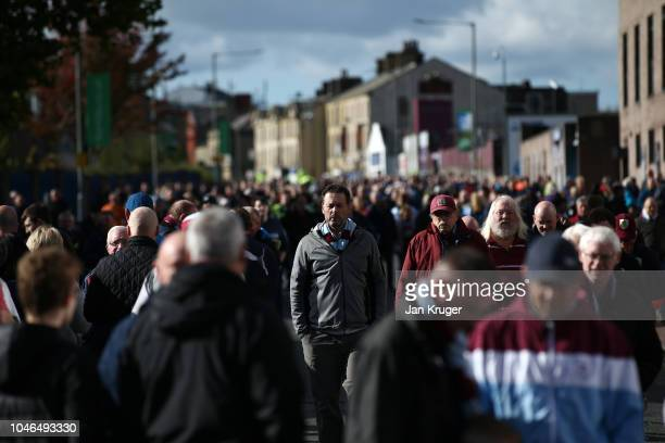Fans arrive at the stadium prior to the Premier League match between Burnley FC and Huddersfield Town at Turf Moor on October 6 2018 in Burnley...