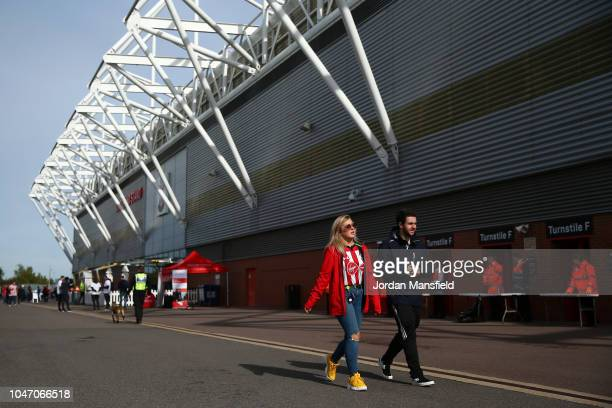 Fans arrive at the stadium prior to the Premier League match between Southampton FC and Chelsea FC at St Mary's Stadium on October 7 2018 in...