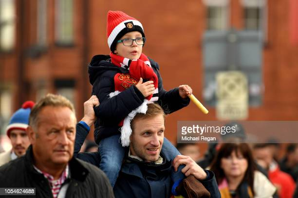 Fans arrive at the stadium prior to the Premier League match between Manchester United and Everton FC at Old Trafford on October 28 2018 in...