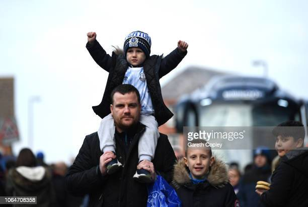 fans arrive at the stadium prior to the Premier League match between Everton FC and Cardiff City at Goodison Park on November 24 2018 in Liverpool...