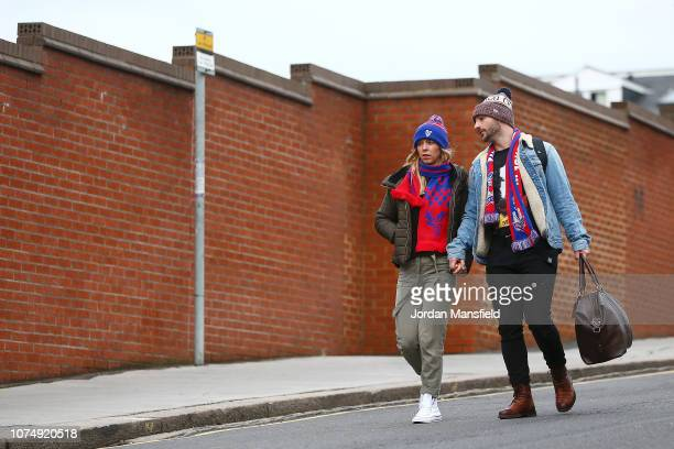 Fans arrive at the stadium prior to the Premier League match between Crystal Palace and Cardiff City at Selhurst Park on December 26 2018 in London...
