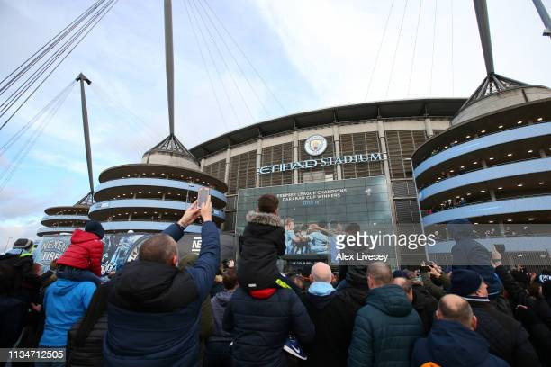 Fans arrive at the stadium prior to the Premier League match between Manchester City and Watford FC at Etihad Stadium on March 09 2019 in Manchester...