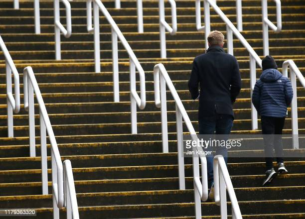 Fans arrive at the stadium prior to the Premier League match between Newcastle United and Manchester United at St James Park on October 06 2019 in...