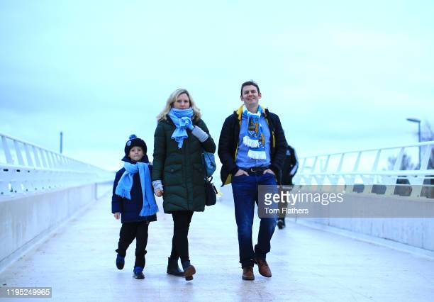 Fans arrive at the stadium prior to the Premier League match between Manchester City and Leicester City at Etihad Stadium on December 21 2019 in...