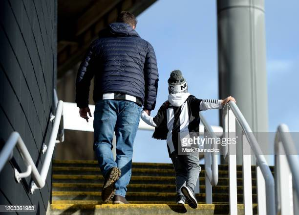 Fans arrive at the stadium prior to the Premier League match between Newcastle United and Norwich City at St James Park on February 01 2020 in...