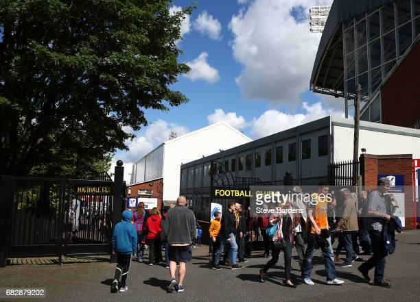 Fans arrive at the stadium prior to the Premier League match between Crystal Palace and Hull City at Selhurst Park on May 14 2017 in London England