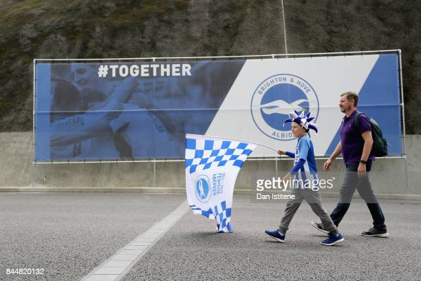 Fans arrive at the stadium prior to the Premier League match between Brighton and Hove Albion and West Bromwich Albion at Amex Stadium on September 9...