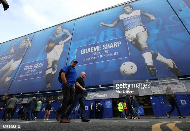 Fans arrive at the stadium prior to the Premier League match between Everton and Burnley at Goodison Park on October 1 2017 in Liverpool England