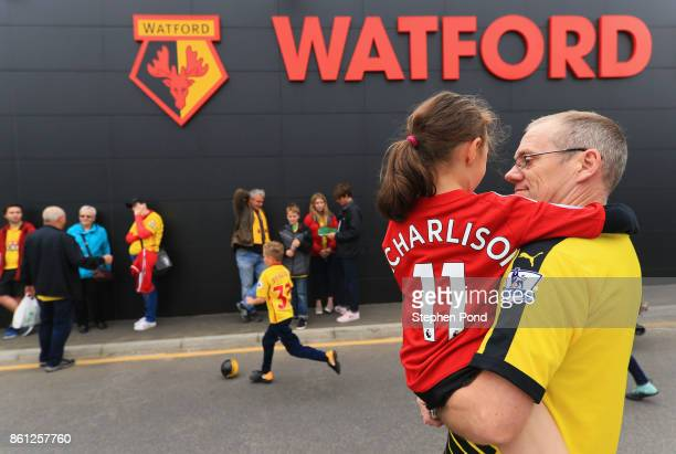 Fans arrive at the stadium prior to the Premier League match between Watford and Arsenal at Vicarage Road on October 14 2017 in Watford England