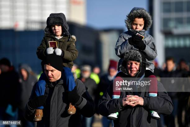 Fans arrive at the stadium prior to the Premier League match between West Ham United and Chelsea at London Stadium on December 9 2017 in London...