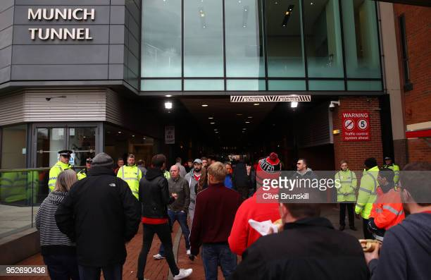 Fans arrive at the stadium prior to the Premier League match between Manchester United and Arsenal at Old Trafford on April 29 2018 in Manchester...